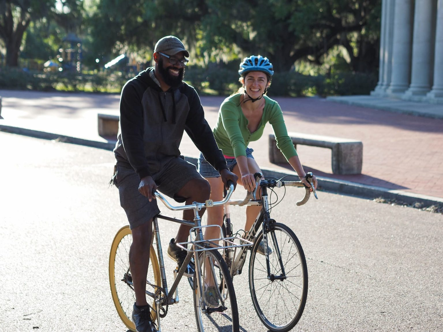 Two people riding bikes